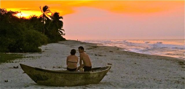 Couple Enjoying Palomino Beach Sunset in a Fishing Canoe