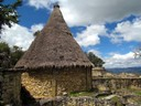 1067 - Reconstruction of a traditional Chacha house Kuelap Peru.JPG