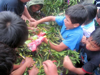 1140 - Kids rush in to collect the loot.JPG